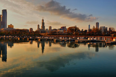 Sunset in The Windy City HDR (Seth Oliver Photographic Art) Tags: chicago clouds buildings reflections illinois nikon midwest skyscrapers searstower cities cityscapes sunsets lakemichigan trumptower southloop hdr highdynamicrange pinoy johnhancockbuilding sheddaquarium urbanscapes marinas secondcity windycity chicagoist d90 burnhamharbor wetreflections handheldshot cityofbigshoulders multipleexposurehdr hdrimages perfectsunsetssunriseandskys willistower setholiver1 sunsetinchicago circularpolarizers 1024mmtamronuwalens parkoneplace