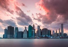 Manhattan Sunset (Jim Boud) Tags: longexposure sunset newyork reflection water skyline brooklyn night buildings landscape evening colorful downtown cityscape skyscrapers nightshot dusk manhattan hudsonriver lightroom artisticphotography jimboud canoneos60d jamesboud canonefs1585mmf3556isusm canon1585mm