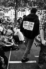 Occupy Wall Street 19 (ifotog, Queen of Manhattan Street Photography) Tags: nyc newyorkcity bw brooklyn protest lowermanhattan ifotog nikond300 leannestaples occupywallstreet
