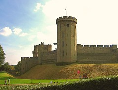 Warwick Castle - Explored 26/11/2011 (helenoftheways) Tags: uk tower castles buildings flag moat warwickcastle historicalbuilding battlements burh