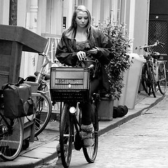 Cycle girl (Akbar Sim (too busy)) Tags: street people bw holland netherlands girl monochrome bicycle zwartwit candid nederland cellphone denhaag smartphone thehague straat mobieltje krat akbarsimonse akbarsim