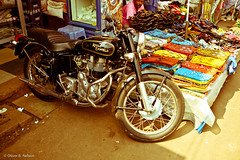 Motorbike in front of shop (oliver.nelson) Tags: india man shop market goa royal 350 bullet cloth enfield lightroom mapusa