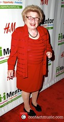 Dr Ruth in a red suit
