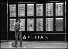 heading home (US Army) (.sanden.) Tags: us military army airport phone call coming home america black white teleprompter sign atlanta ga delta airlines sanden
