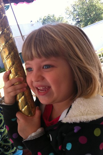 happy Catie on the merry-go-round
