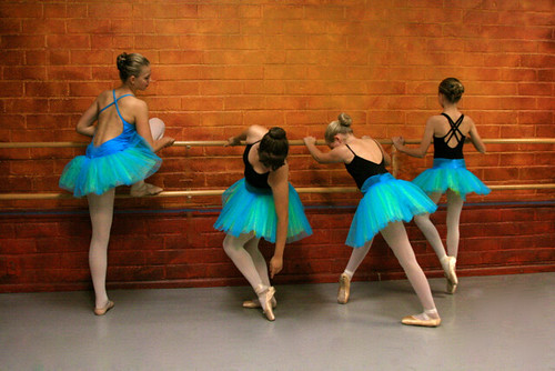 Young Ballet Dancers Stretching at the Barre... Reminiscent of Degas...