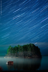 Out After Midnight... (AndWhyNot) Tags: trees lake water field night suomi finland stars landscape island star book bay nikon long exposure f14 yo wide trails astro cover lahti 24mm kuopio maisema vesi afs startrails manfrotto d300 saari hardback softback puut jarvi 5636 tahti honkalahti tahdet valotusajalla pitkalla polkuja