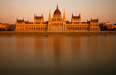 Hungarian Parliament at Sunset (markrellison) Tags: longexposure sunset orange holiday reflection building canon europe hungary unitedkingdom spires budapest parliament wideangle 7d reflective f11 danube gbr 35s ndfilter bluedanube 1755efs nd1000