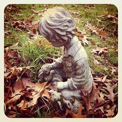 Little Stone Boy and his Rabbit Friends (liquidnight) Tags: camera autumn boy pets bunny fall love cemetery grave graveyard grass leaves animals statue stone children square portland death moss memorial sitting child affection sweet small touch young ground foliage squareformat mementomori pdx rabbits melancholy statuary seated fragile caress tender gentle mortality iphone lonefir iphone4 iphoneography instagram instagramapp uploaded:by=instagram foursquare:venue=4a9b11a1f964a5204a3420e3