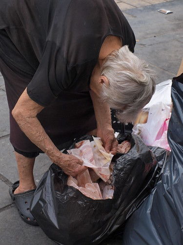 Greek pensioner looking through rubbish for leftover food by Teacher Dude's BBQ