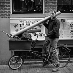 The plumber (Iam Marjon Bleeker) Tags: holland amsterdam bike bicycle biker plumber zeedijk manonabike manonabikeinamsterdam skylounge074