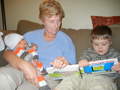 Dominic reading to Leo