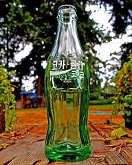 Korean cola bottle () Tags: old usa green classic glass logo asian photo interesting close cross image cola artistic drink unique united beverage picture culture coke korea pop nostalgia korean photograph processing nostalgic soda cocacola states foreign brand vignette collector