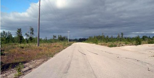 abandoned street, Pine Point (via John Sandlos, via Network in Canadian History & Environment)