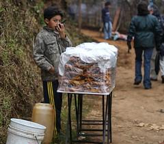 Cambio y Fuera... (juandeleon) Tags: road boy festival radio giant vendedor technology camino guatemala kites trail honey miel flakes sales tierra gigantes sumpango muchacho barriletes hojuelas