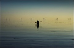 Gone Fishing!! (adrians_art) Tags: blue people water reflections coast fishing haze waves ripples windfarm windturbines