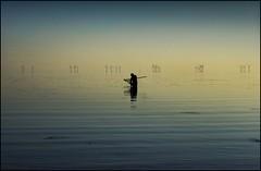 Gone Fishing!! (adrians_art) Tags: blue people water reflections coast fishing haze waves ripples windfarm windturbines
