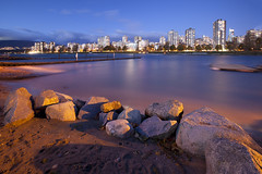 Overlooking Vancouver from Vanier Park (Claire Chao) Tags: longexposure bridge november autumn sunset urban canada rock vancouver canon pier rocks downtown cityscape waterfront sundown harbour britishcolumbia jetty bluewater windy bluesky clear falsecreek l englishbay nightview bluehour dust westend clearsky nightfall citylight aftersunset longexposures vanierpark downtownvancouver creekside wideanglelens customwhitebalance 2011 llens sunsetview customwb 11thnovember clearair canonllens westendvancouver stormywind cityviewatnight canon1635mmf28 canoneos5dmarkii 11112011 westendofvancouver 1635mmllens 5000k0