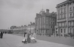 H00028 Sussex Hotel, Marina, St. Leonards  c.1905 (East Sussex Libraries Historical Photos) Tags: horse baby architecture marina buildings costume library promenade shelter edwardian pram 1905 broderick stleonardsonsea sussexhotel