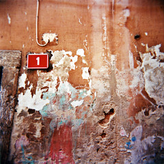 Una questione di poca importanza (ale2000) Tags: door red orange 6x6 facade mediumformat square one 1 holga lomography decay number un uno capodistria 400 porta photowalk rosso arancio numero arancione ruined portone koper rovina facciata ruination lomography400
