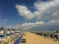 umbrellas&sky (ΞSSΞ®®Ξ) Tags: blue light sea summer sky italy white seascape beach water weather june yellow clouds contrast landscape vanishingpoint sand beige colorful dof view angle pov walk details perspective scenic diagonal clear parasol framing depth baywatch abruzzo breakwater iphone rihanna