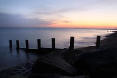 (natipersson) Tags: ocean longexposure sunset sea sky sun motion reflection beach water clouds landscape rocks waves silhoutte groins