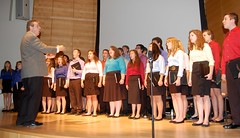 The Windham Chamber Singers from Windham High School perform on stage at the University of Southern Maine in Portland.