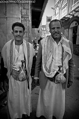 two men in traditional clothes with the Jambiya and hung the bag of qat in the qat market -sana'a-yemen (anthony pappone photography) Tags: travel portrait people canon pose photography photo faces image expression retrato picture portraiture arabia drug yemen fotografia sanaa ritratto reportage photograher qat yemeni phototravel jambiya arabie arabiafelix eos5dmarkii