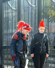 Red Conehead (knightbefore_99) Tags: street red black silly station vancouver corner funny punk candid clown hairdo ridiculous grandview skytrain commercialdrive eastvan conehead thedrive