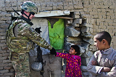 Friendly handshake (The U.S. Army) Tags: afghanistan army refugee navy orphans af airforce kabul kaia ijc oef operationenduringfreedom october20 operationoutreach humanitartianaide