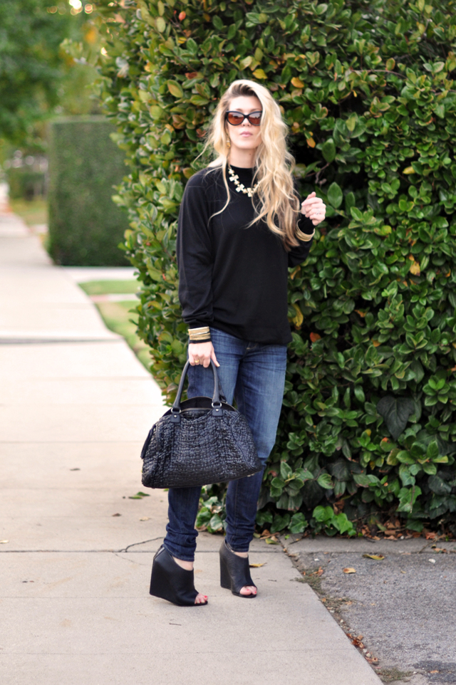 black sweater + brass jewelry+jeans+black wedges+black woven leather bag+cat eye sunglasses+long messy hair