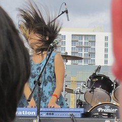 picture three of three of Yuki Chikudate's at the keyboards, her hair blowing up
