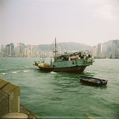 A Boat and Another Boat (©skarson) Tags: china 120 film analog boats hongkong boat asia lubitel2 lubitel fujifilm victoriaharbour fujicolor