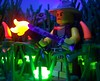 Who's Hunting Who (Silenced_pp7) Tags: park light black girl grass night dark blood shot dino lego dinosaur fig who hunting mini creation blacklight raptor nightime hunter tall minifig bloody machete custom jurassic dinosaurs clever whos minifigure moc clevergirl rapter brickarms