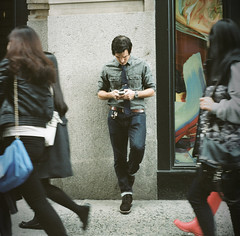 Texting (gregorhofbauer) Tags: man male 120 film fashion wall mediumformat break phone sidewalk busy leaning yashica typing yashicad