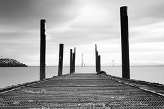 The Jetty (Anthony Owen-Jones) Tags: ocean uk longexposure sea blackandwhite bw cloud white seascape black bird water monochrome lines wales clouds canon lens landscape eos rebel mono bay coast landscapes photo seaside kiss europe long exposure unitedkingdom jetty horizon north perspective picture gimp filter photograph walkway ethereal nd kit postprocess bnw conwy groynes t3i x5 rhosonsea colwynbay northwales rhos onsea colwyn 600d takenwith 10stop nd110 canonefs1855mmf3556is rebelt3i kissx5