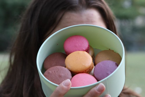 Jen with Macarons on the Champ de Mars