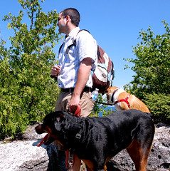 Hiking 2 (one.juniper) Tags: flowers blue trees summer dog lake ontario canada green beach water swimming puppy boat nationalpark divers marine rocks hiking turquoise georgianbay aquamarine trails july rocky biosphere diving rottweiler caesar cliffs greatlakes snorkeling caves photoaday pebblebeach grotto hikers winnie brucepeninsula saintbernard winston stbernard dailyphoto lakehuron tobermory cliffjumping cliffface brucepeninsulanationalpark rotti crystalclear marinepark scubadivers brucecounty indianheadcove unescobiospherereserve 92daysofsummer summerofmoments juniperpast