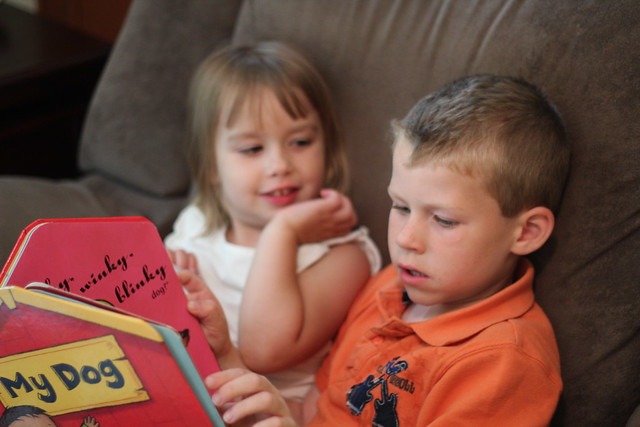 Benjamin reading to Kelsey