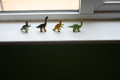 (rach !) Tags: window animals toys inspired ledge dinosaurs
