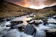 Sunset_stream2 (PeterChad) Tags: sunset snow water scotland movement stream heather burn brook chippy brrr lanarkshire lanark rosk megget holdthataminute