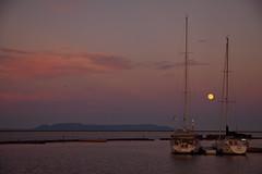 Full moon between masts (KarenR-TB) Tags: sunset ontario marina dusk fullmoon sailboats lakesuperior thunderbay sleepinggiant