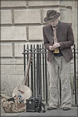 Busker checking his takings. (Tuppence 2009) Tags: street city musician texture bath handmade candid instrument busker 13 textured billingham motat hss nx2 tatot darkwood67 elements9 111picturesin2011
