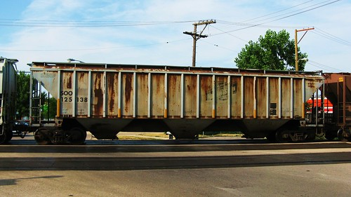 A former Chicago & NorthWestern Railroad covered hopper car in transit. Chicago Illinois USA. July 2011. by Eddie from Chicago