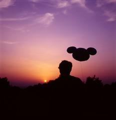 (Benjamin Skanke) Tags: boy sunset man 120 6x6 tlr film silhouette square lens mouse spain balloon twin slide mickey alicante mat 124g medium format 100 epp expired 35 ektachrome yashica canoscan 120mm 80mm yashinon