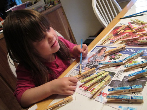 Painting her butterfly bodies