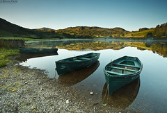 Watendlath Boats (.Brian Kerr Photography.) Tags: light shadow mist mountains fog sunrise canon reflections landscape boats lakes lakedistrict hills cumbria watendlath eos5dmkii briankerrphotography