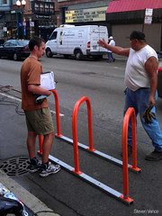 Crews working (Steven Vance) Tags: road street orange wickerpark bike bicycling design wpb bicicleta transportation vlo bikerack ssa roadway dero milwaukeeavenue bikeparking bikecorral wickerparkbucktown onstreetbikeparking ssa33 bikeparkingcorral bikechi wpbrides