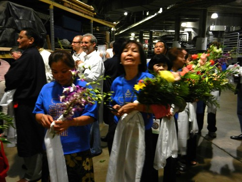 Volunteers lining up with bouquets of fresh flowers and khatas, as offerings, preparing for mandala offering to His Holiness 14th Dalai Lama of Tibet, Kalachakra for World Peace, Verizon Center, Washington D.C. USA by Wonderlane