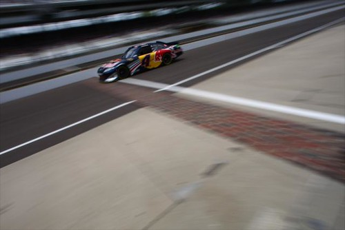 The Red Bull car crosses over the yard of bricks